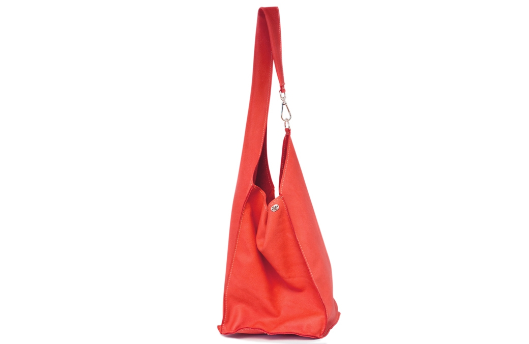 red bag with snap hook detail